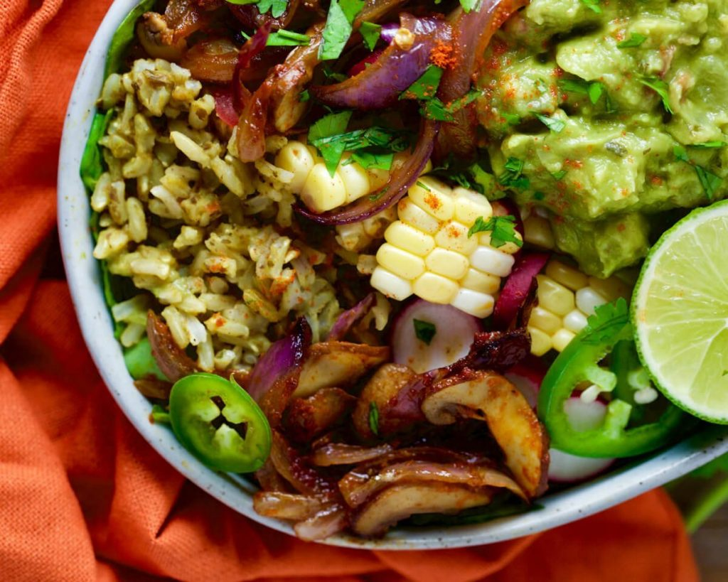 Mexican vegetable rice bowl food heaven made easy start by adding the black bean rice to your bowls then add the mushroom saut then the vegetables guacamole and fresh cilantro for the forumfinder Choice Image